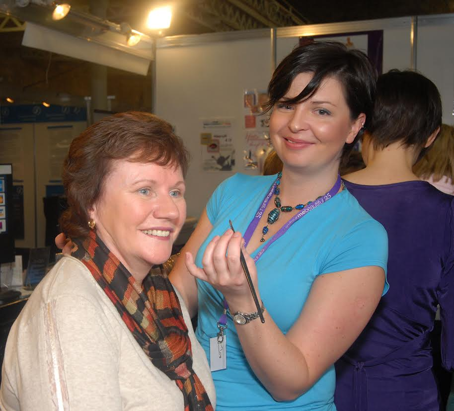Naomi Power gives Mary Hoventy a makeover at the Colour Me Beautiful stand